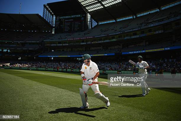 David Warner and Joe Burns of Australia walk out to bat during day three of the Second Test match between Australia and the West Indies at the...