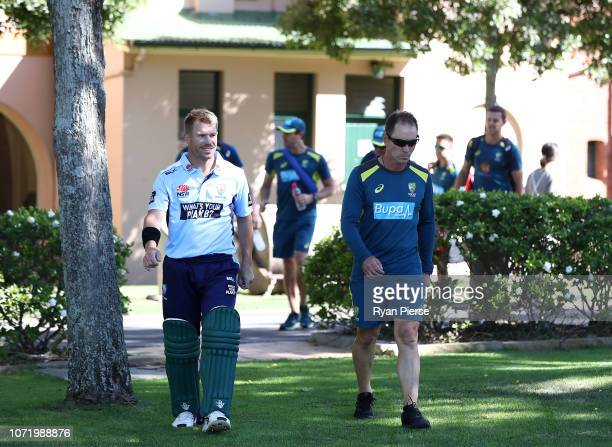 David Warner and Justin Langer coach of Australia walk to the nets before the International Twenty20 match between Australia and India at Sydney...
