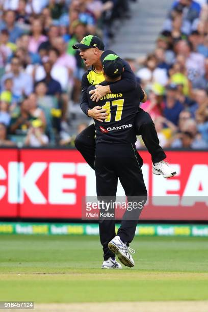 David Warner and Marcus Stoinis of Australia celebrate Warner running out Dawid Malan of England during game two of the International Twenty20 series...