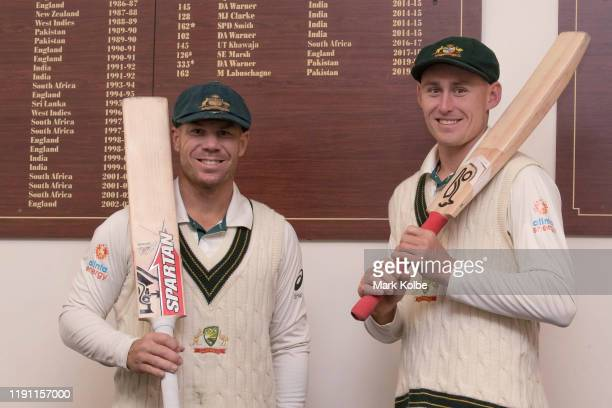 David Warner and Marnus Labuschagne of Australia pose in front of their names on the honour board for test match centuries for Australia scored at...