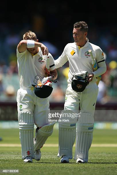 David Warner and Michael Clarke of Australia leave the field at lunch during day one of the First Test match between Australia and India at Adelaide...