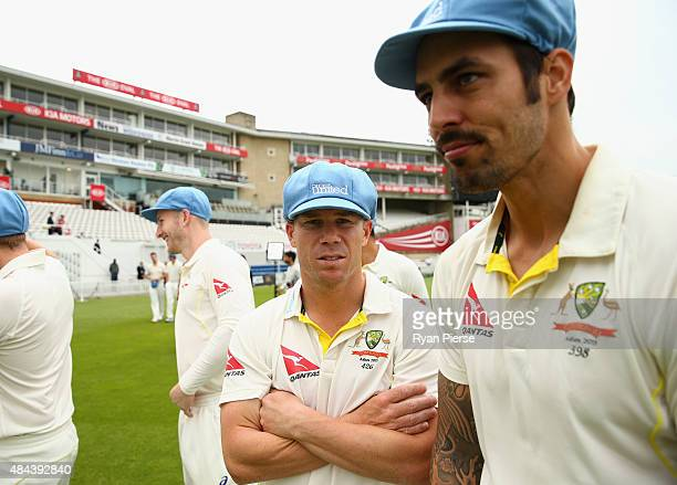 David Warner and Mitchell Johnson of Australia walk out for the Cricket United charity team photo during a nets session ahead of the 5th Investec...
