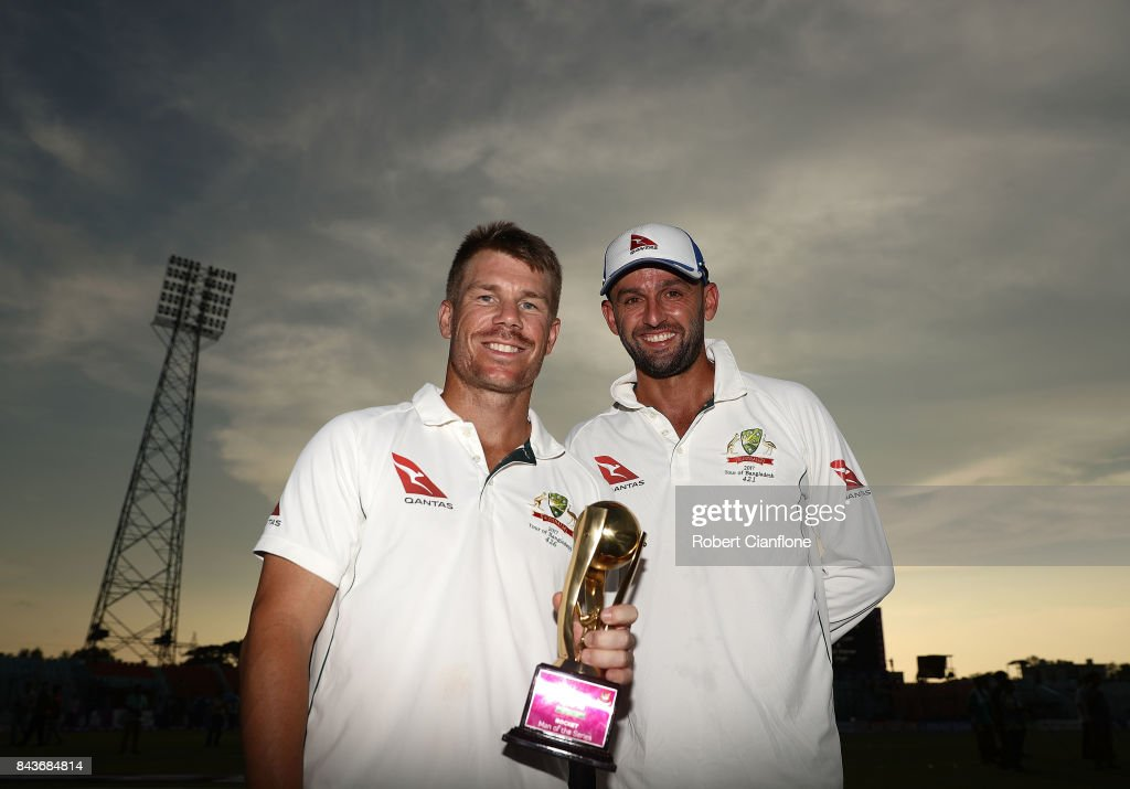 David Warner and Nathan Lyon of Australia pose with the Man of the Series trophy after Australia defeated Bangladesh on day four of the Second Test match between Bangladesh and Australia at Zahur Ahmed Chowdhury Stadium on September 7, 2017 in Chittagong, Bangladesh.