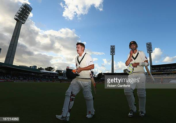 David Warner and Nathan Lyon of Australia walk off the ground after the end of play on day one of the Third Test Match between Australia and South...