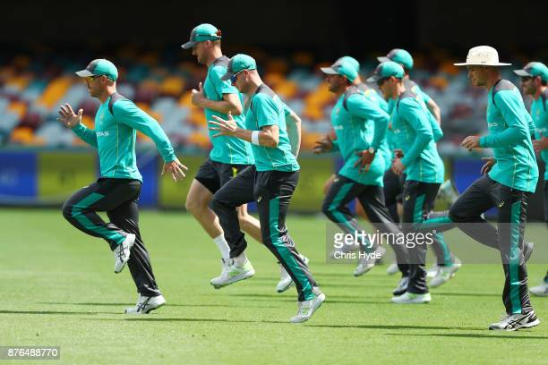 David Warner and Steve Smith lead the team through drills during an Australia training session at The Gabba on November 20 2017 in Brisbane Australia