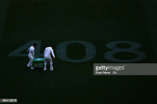 David Warner and Steve Smith of Australia carry an esky of beer before the Australian Cricket Team gathered over the '408' to sing the team song in a...