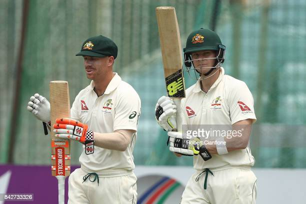 David Warner and Steve Smith of Australia head out to bat during day two of the Second Test match between Bangladesh and Australia at Zahur Ahmed...