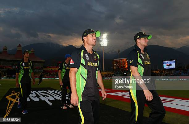 David Warner and Steve Smith of Australia lead their team from the ground after the ICC World Twenty20 India 2016 Super 10s Group 2 match between...