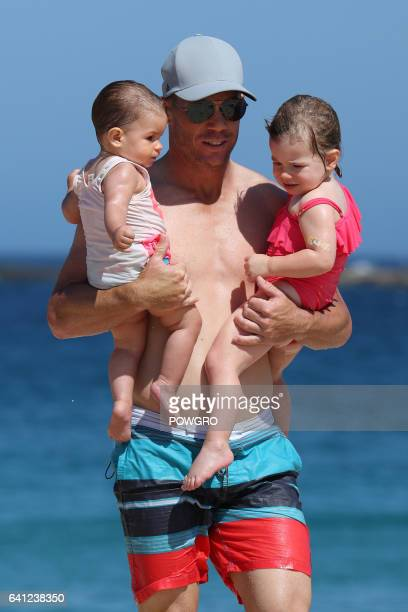 David Warner and wife Candice Falzon pictured with their kids Ivy and Indi at a Sydney beach on January 30 2017 in Sydney Australia
