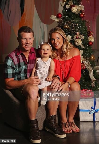 David Warner and wife Candice Warner pose with duaghter Ivy during the Australian Test Squad Christmas Day Luncheon at Crown Entertainment Complex on...