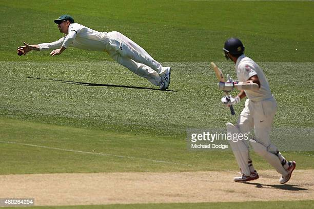 David Warner dives for the ball after Cheteshwar Pujara of India plays a stroke during day three of the First Test match between Australia and India...