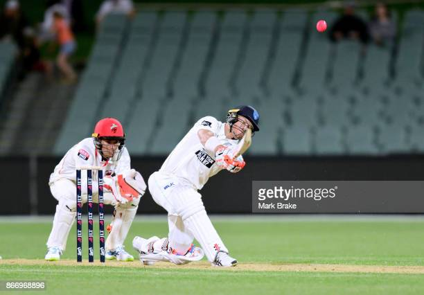 David Warner hits over cover on his way to 50 during day one of the Sheffield Shield match between South Australia and New South Wales at the...