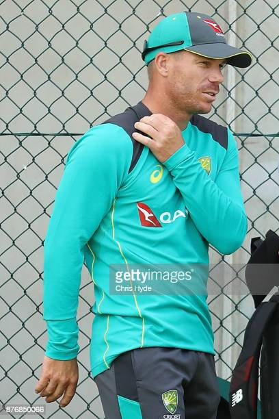 David Warner hold his neck during the Australian nets session at The Gabba on November 21 2017 in Brisbane Australia