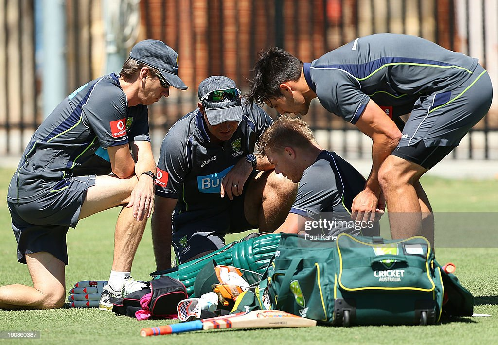 David Warner is checked by rehabilition manager Kevin Sims (L), coach Mickey Arthur and Mitchell Johnson after being struck on the left hand by Mitchell Johnson during an Australian One Day International training session at WACA on January 30, 2013 in Perth, Australia.