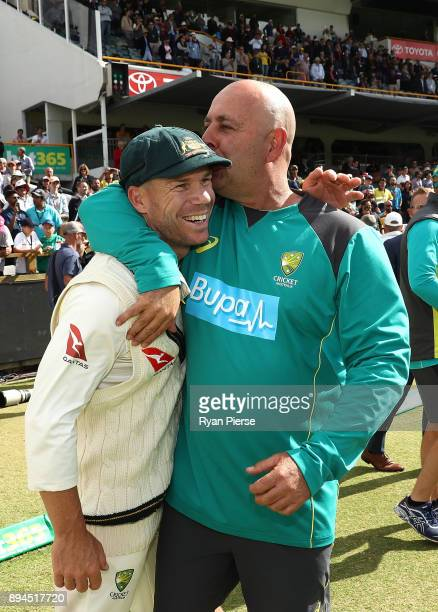 David Warner of Australia and Australian Head Coach Darren Lehmann celebrate after Australian claimed victory during day five of the Third Test match...