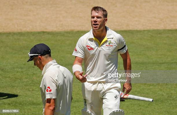 David Warner of Australia and bowler Tom Curran of England exchange words after Warner reached his century during day one of the Fourth Test Match in...