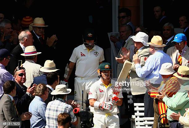 David Warner of Australia and Chris Rogers of Australia walk out to bat during day four of the 2nd Investec Ashes Test match between England and...
