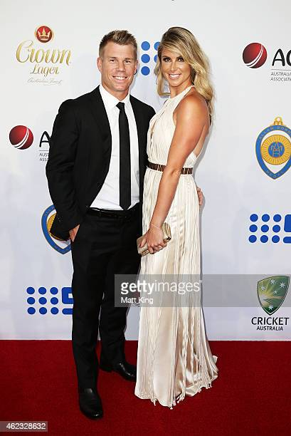 David Warner of Australia and fiance Candice Falzon arrive ahead of the 2015 Allan Border Medal at Carriageworks on January 27 2015 in Sydney...