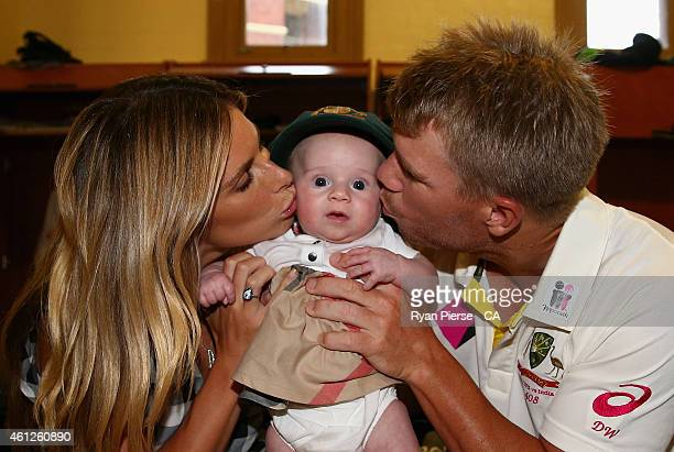 David Warner of Australia and his fiance Candice Falzon pose with their daughter Ivy in the change rooms after day five of the Fourth Test match...