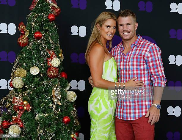 David Warner of Australia and his partner Candice Falzon pose ahead of the Cricket Australia Christmas Day Lunch at Crown Metropol on December 25...