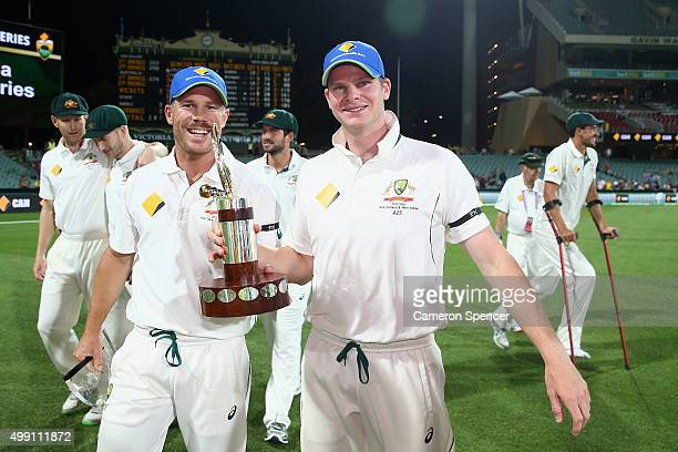 David Warner of Australia and Steve Smith of Australia celebrate with the Transtasman trophy after winning the series 20 during day three of the...