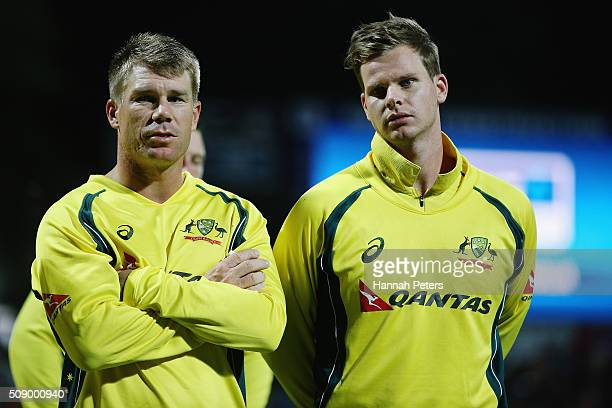 David Warner of Australia and Steve Smith of Australia look on after losing the 3rd One Day International cricket match between the New Zealand Black...