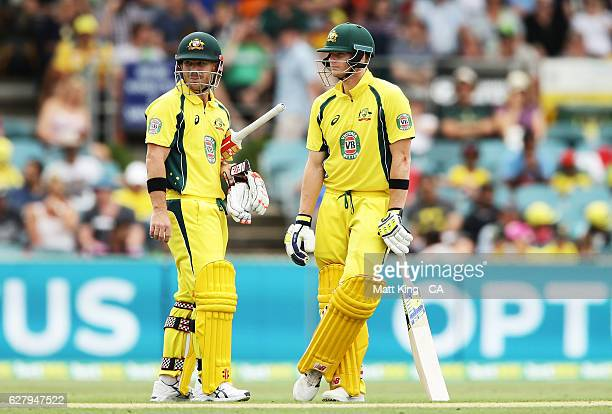 David Warner of Australia and Steve Smith of Australia talk between overs during game two of the One Day International series between Australia and...
