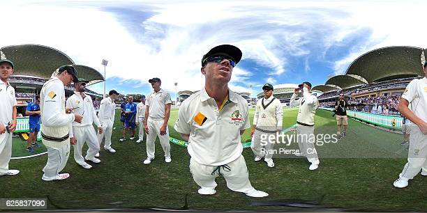David Warner of Australia and The Australian Cricket Team prepare to take to the field during day three of the Third Test match between Australia and...
