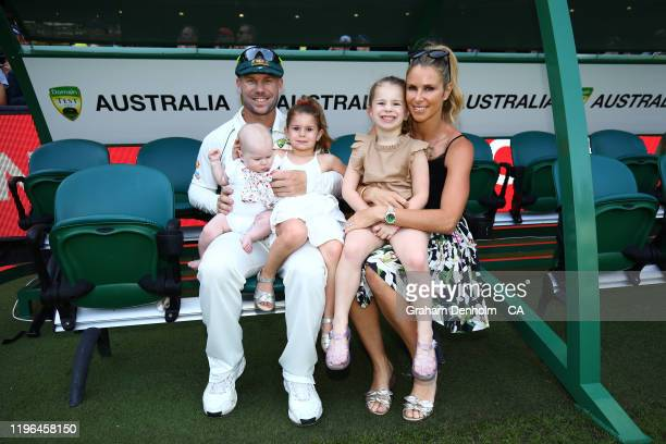 David Warner of Australia and wife Candice Warner embrace their daughters following victory in the Second Test match in the series between Australia...