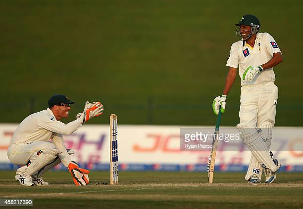 David Warner of Australia and Younis Khan of Pakistan share a joke during Day Three of the Second Test between Pakistan and Australia at Sheikh Zayed...