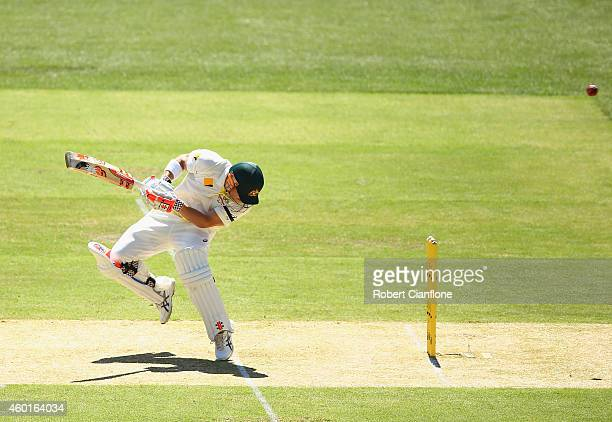 David Warner of Australia avoids a bouncer from Varun Aaron of India during day one of the First Test match between Australia and India at Adelaide...