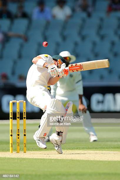 David Warner of Australia avoids a short pitched delivery during day one of the First Test match between Australia and India at Adelaide Oval on...