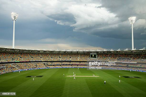 David Warner of Australia bats as a storm approaches during play on day three of the First Test match between Australia and New Zealand at The Gabba...