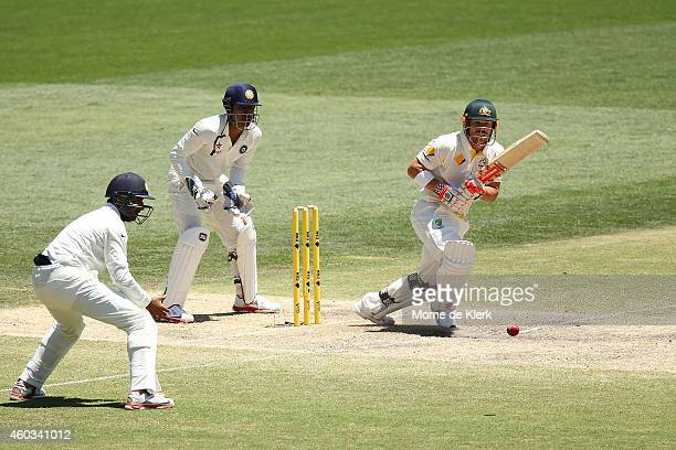 David Warner of Australia bats in front of Wriddhiman Saha of India during day four of the First Test match between Australia and India at Adelaide...