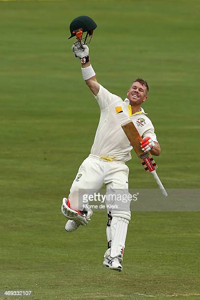 David Warner of Australia celebrates after reaching 100 runs during day three of the First Test match between South Africa and Australia on February...