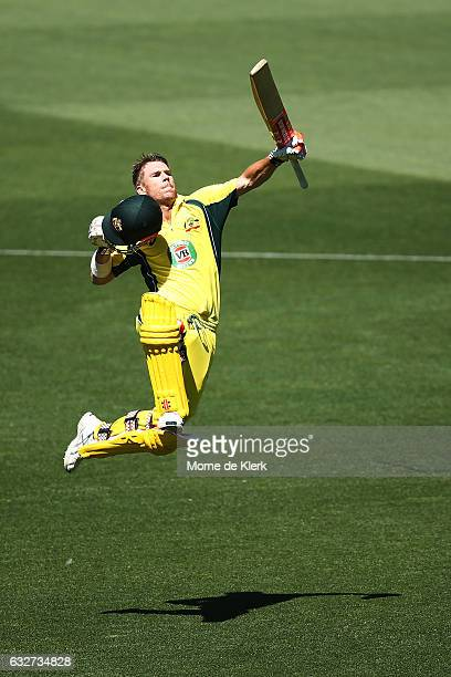 David Warner of Australia celebrates after reaching 100 runs during game five of the One Day International series between Australia and Pakistan at...