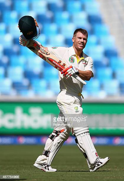David Warner of Australia celebrates after reaching his century by signaling to his fiance and Candice Falzon and baby girl Ivy during Day Three of...