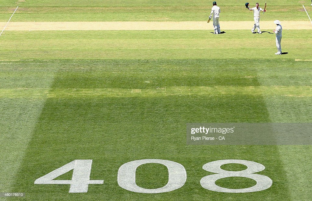 David Warner of Australia celebrates after reaching his century during day one of the First Test match between Australia and India at Adelaide Oval on December 9, 2014 in Adelaide, Australia.