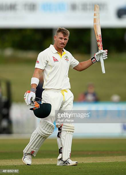 David Warner of Australia celebrates after reaching his century during day one of the Tour Match between Derbyshire and Australia at The 3aaa County...