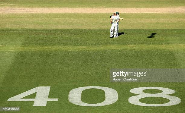 David Warner of Australia celebrates after reaching his century with teammate Steve Smith during day four of the First Test match between Australia...