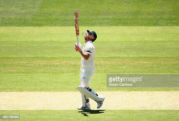 David Warner of Australia celebrates after reaching his half century during day one of the First Test match between Australia and India at Adelaide...