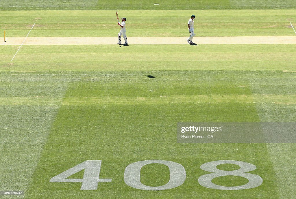 David Warner of Australia celebrates after reaching his half century during day one of the First Test match between Australia and India at Adelaide Oval on December 9, 2014 in Adelaide, Australia.