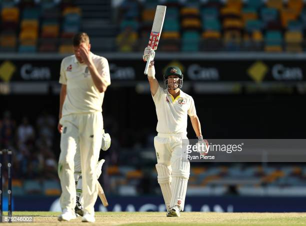 David Warner of Australia celebrates after reaching his half century as Jake Ball of England walks back to his mark during day four of the First Test...