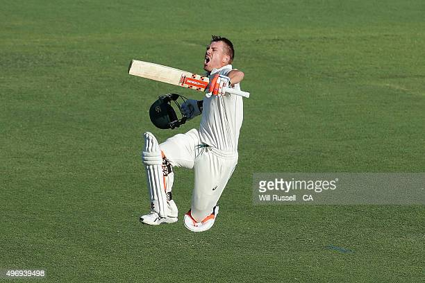 David Warner of Australia celebrates after reaching his second century during day one of the second Test match between Australia and New Zealand at...