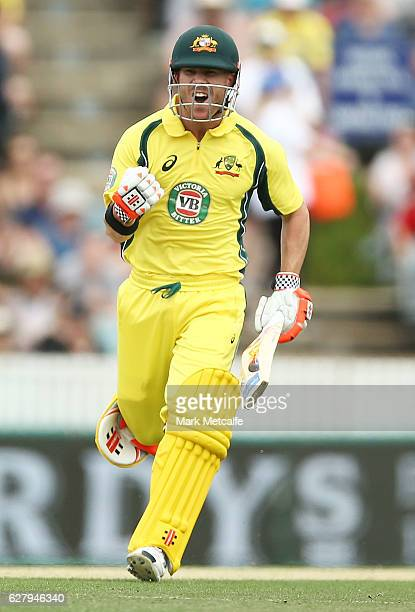 David Warner of Australia celebrates after scoring a century during game two of the One Day International series between Australia and New Zealand at...