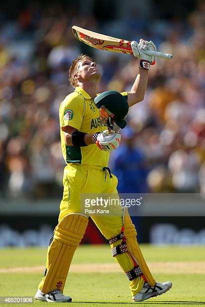 David Warner of Australia celebrates after scoring his century during the 2015 ICC Cricket World Cup match between Australia and Afghanistan at WACA...