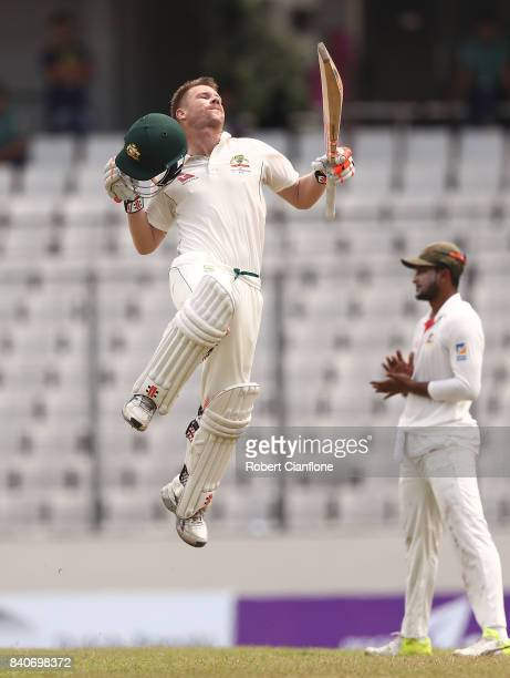 David Warner of Australia celebrates after scoring his century during day four of the First Test match between Bangladesh and Australia at Shere...