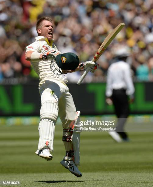David Warner of Australia celebrates after scoring his century during the first day of the fourth Ashes cricket test match between Australia and...