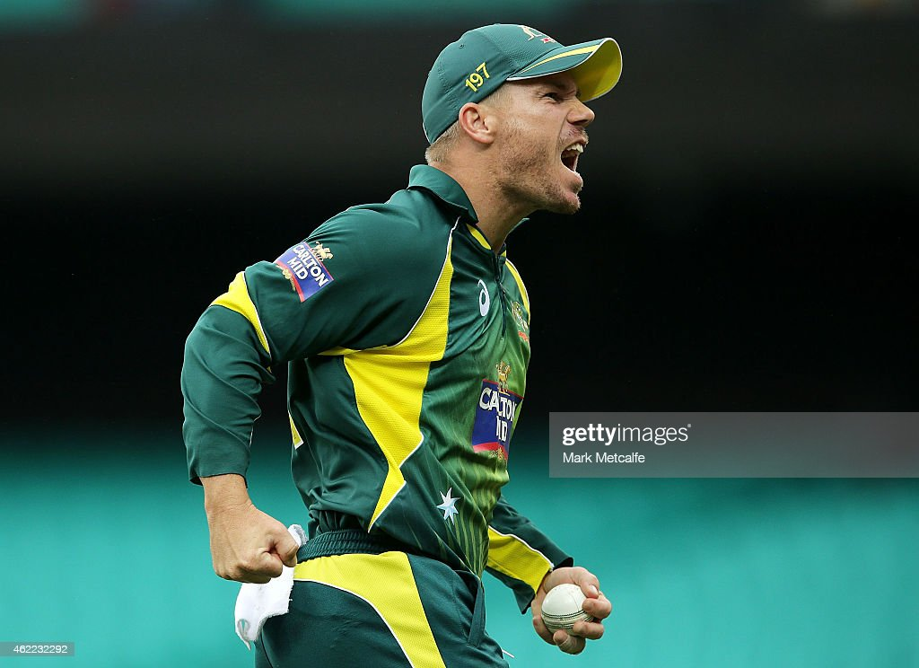 David Warner of Australia celebrates after taking a catch to dismiss Ambati Rayudu of India off the bowling of Mitchell Marsh during the One Day International match between Australia and India at Sydney Cricket Ground on January 26, 2015 in Sydney, Australia.