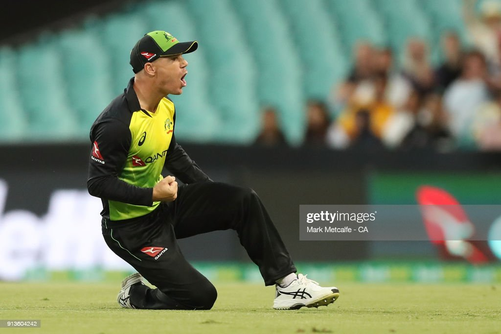 David Warner of Australia celebrates after taking a catch to dismiss Kane Williamson of New Zealand during game one of the International Twenty20 series between Australia and New Zealand at Sydney Cricket Ground on February 3, 2018 in Sydney, Australia.